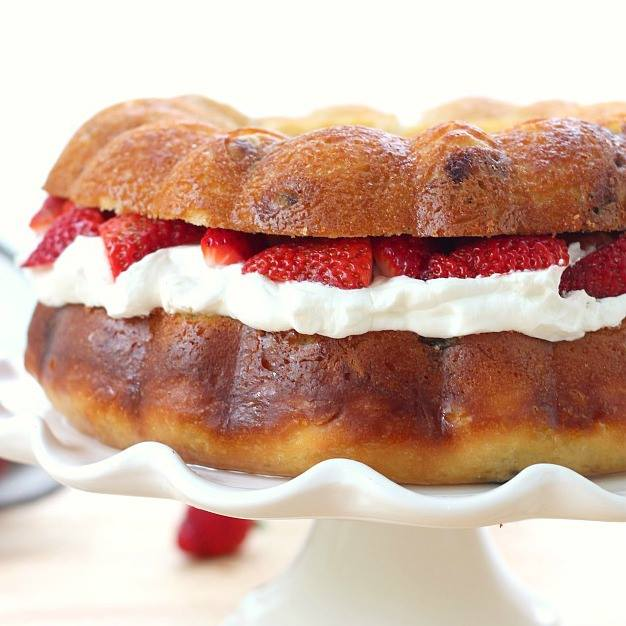 BABA AU RHUM WITH CREAM AND STRAWBERRIES