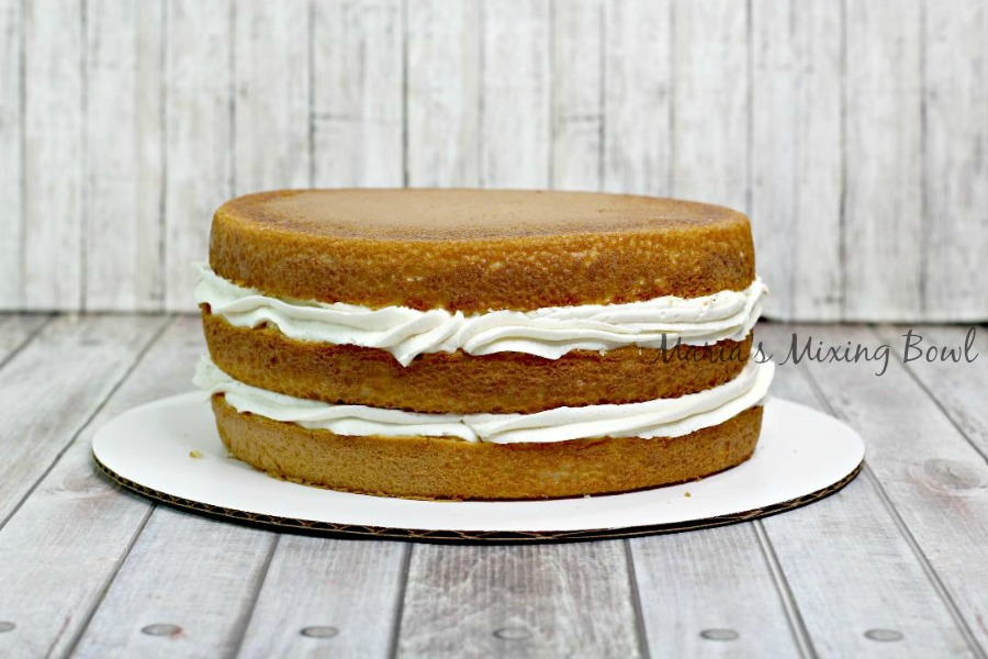 Three layers of cake with banana pudding filing and frosting in between