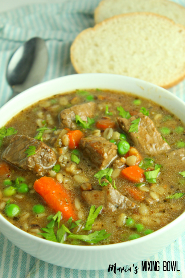 bowl of beef soup with bread slices