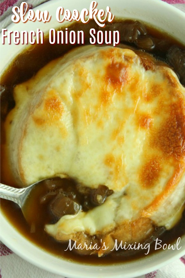 Slow cooker French onion soup in white bolw with spoon