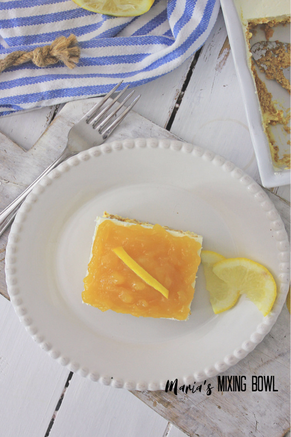 Lemon Icebox Cake with lemon slice on white plate