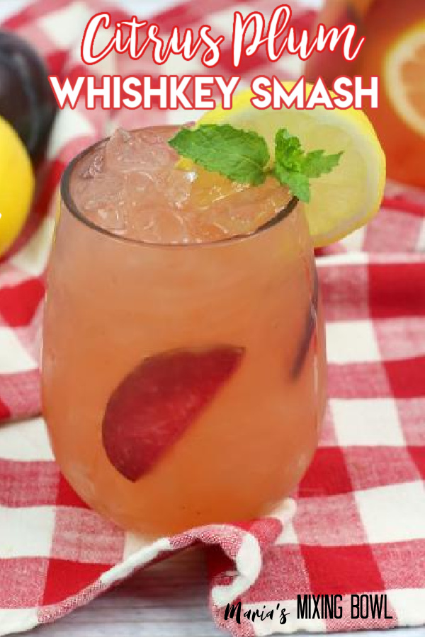 Citrus Plum Whiskey Smash on a red and white plaid napkin