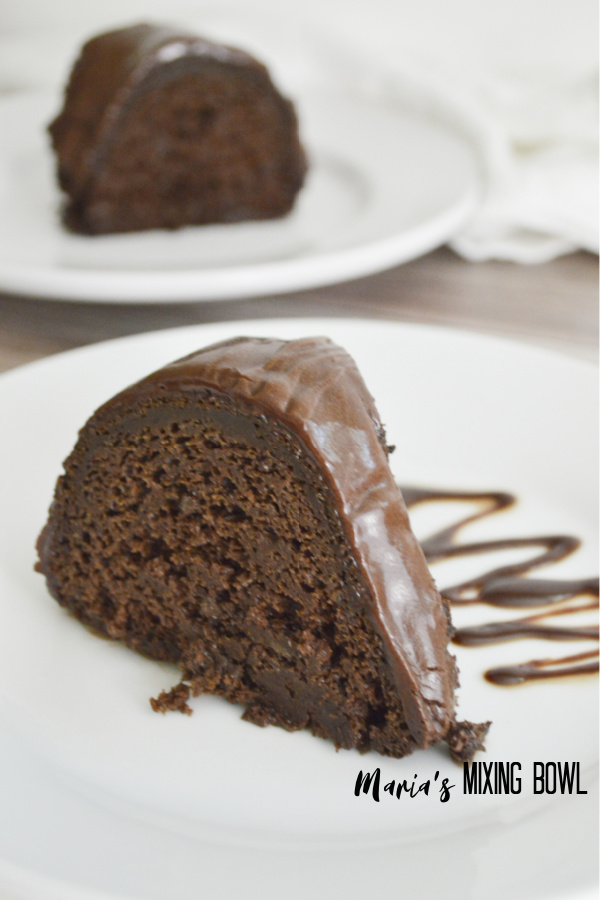 Fudgy Chocolate Pumpkin Bundt Cake slice with fudge sauce on the side