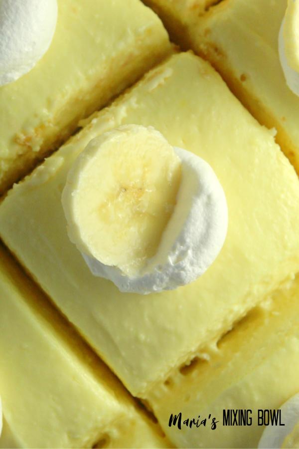 Banana Cream Cheesecake Bars with whipped Cream and Banana