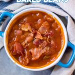 Easy Baked Beans in a blue baking dish with blue and with napkin