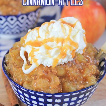 cinnamon apples in a blue and white bowl topped with whipped cream with apples