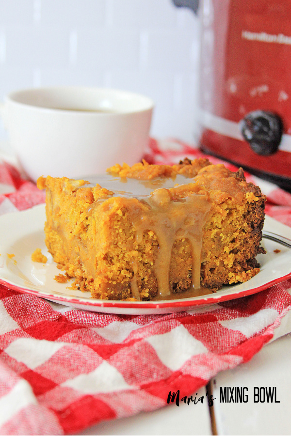 pumpkin dessert on a red, white check napkin a white cup in the back ground and red crockpot