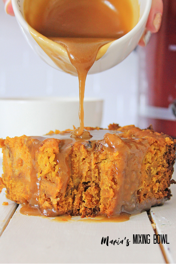 pumpkin dessert with caramel sauce white cup in background and red crockpot