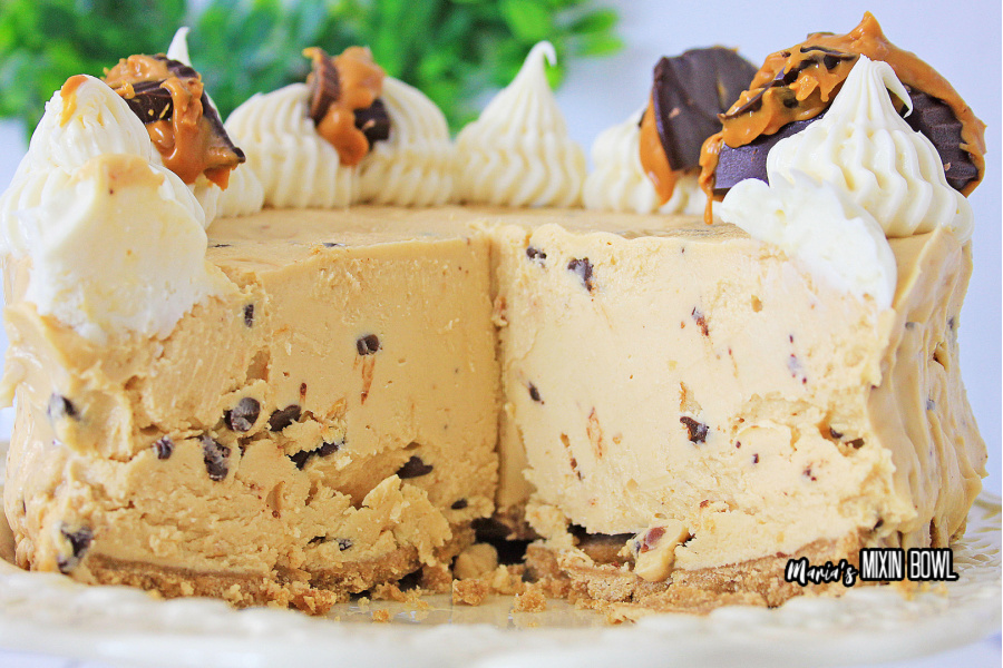 cheesecake with cream cheese frosting and peanut butter cups