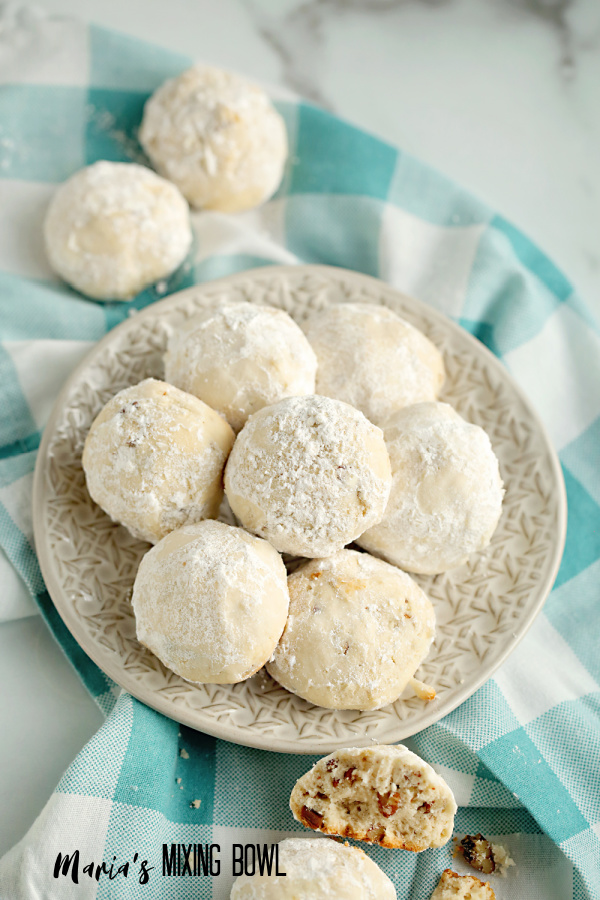cookies on beige plate and blue and white check napkin