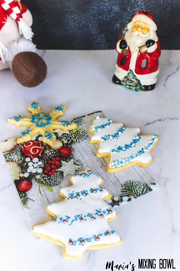 tree shaped , star shaped cookies on a marble couneter