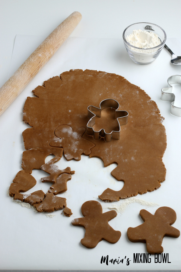 cutting out cookies rolling pin, flour spoon, cookie cutters