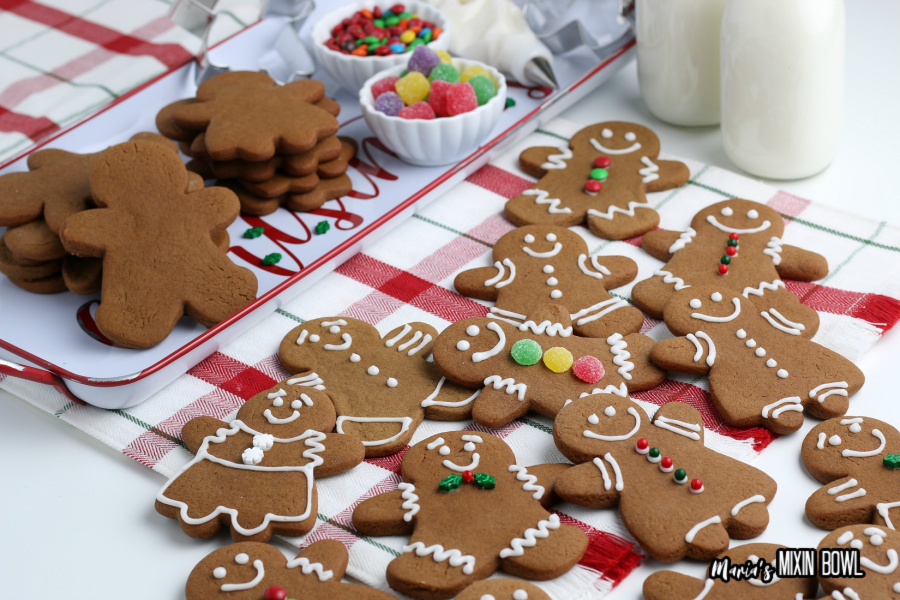 Gingerbread Cookies being decorated on a white and red check napkin