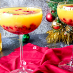 cocktails on red napkin in front of Christmas tree