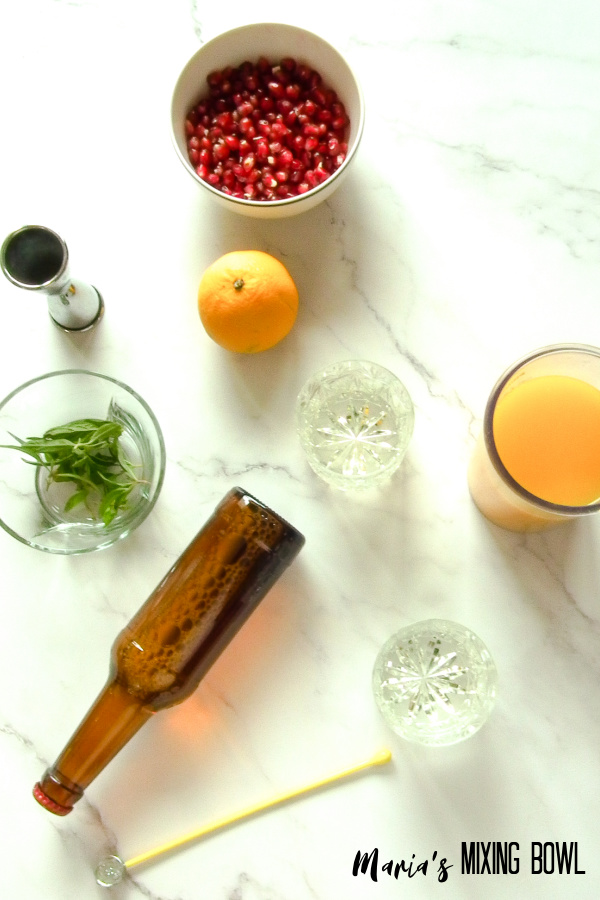 ingredients for holiday drink on a marble table