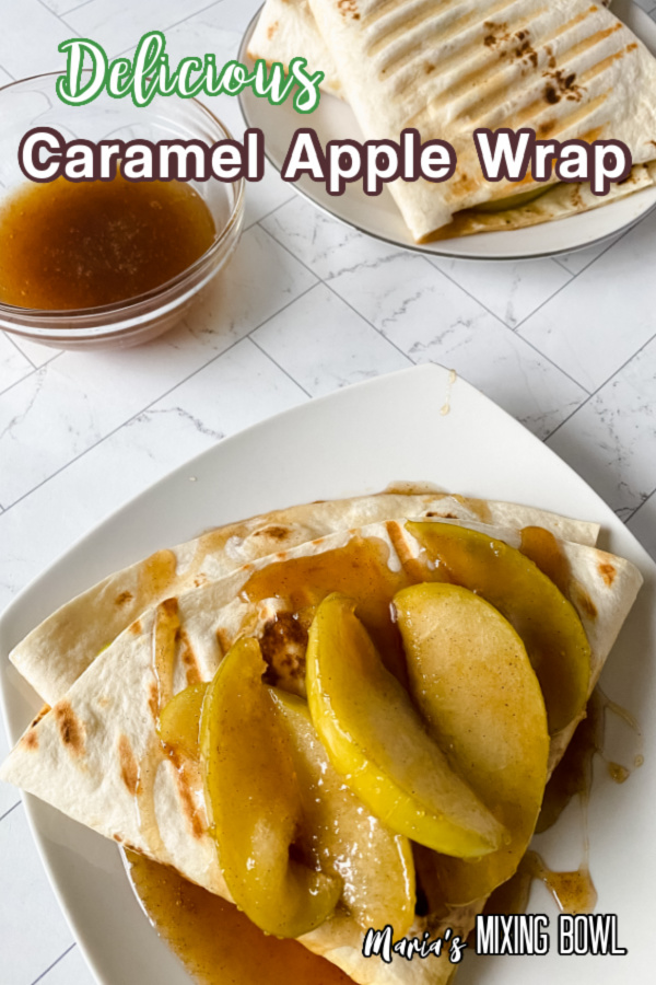Caramel apple wrap topped with caramel and apple wedges on plate.