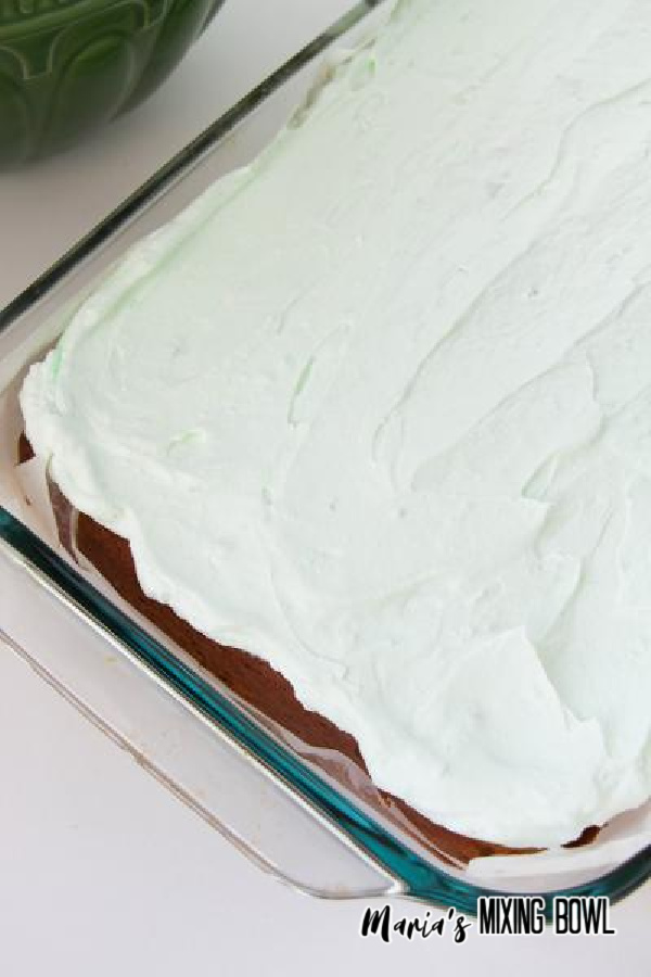 Pudding layer over cake in glass baking dish.