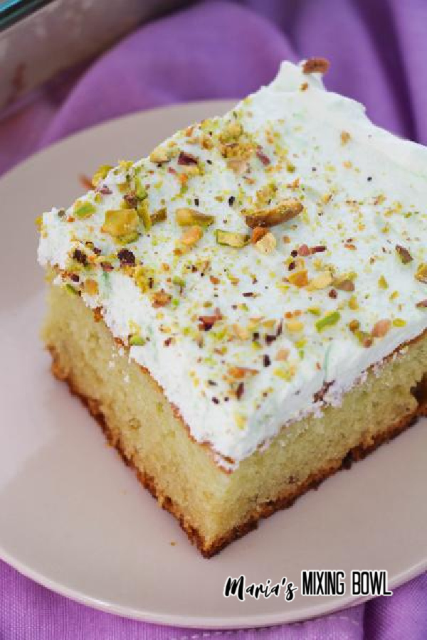 Close up of pistachio cake on white plate.