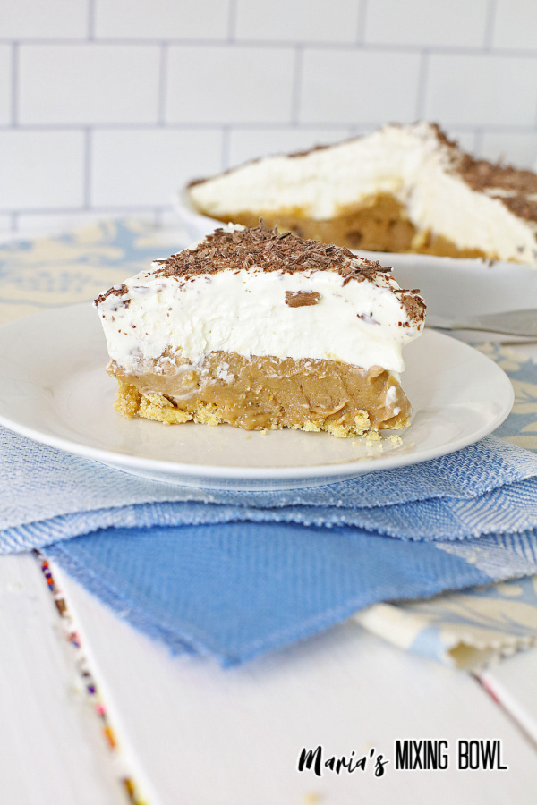 dessert pie on white plate with blue and white napkin