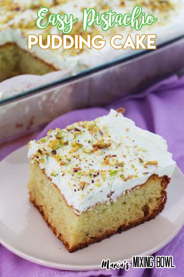 Slice of easy pistachio pudding cake on white plate with remaining cake in baking dish in background.