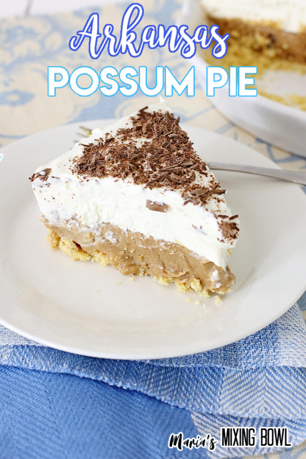 Possum pie on white plate with fork.