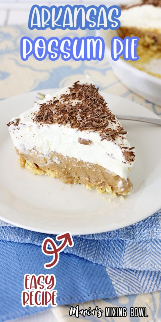 Slice of chocolate whipped cream pie on white plate with fork