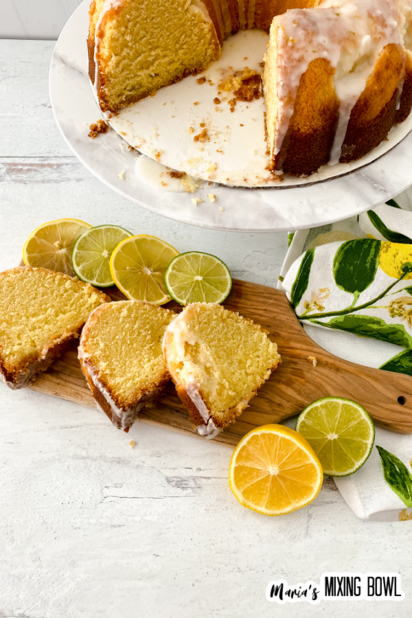 Overhead shot of lemon lime bundt cakes lices on cutting board with more cake on cake stand