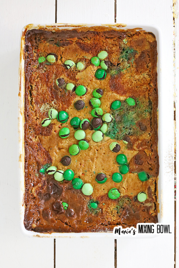Overhead shot of cooked cake topped with M&Ms in white baking dish