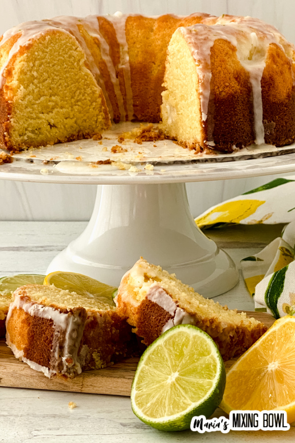 Cake on cake stand with slices in front