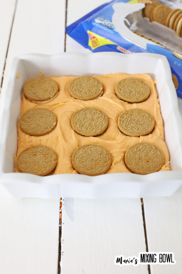 Baking dish with layer of fudge batter topped with Oroe cookies