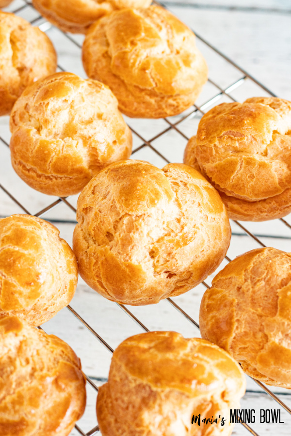 Baked puffs before cutting on wire cooling rack