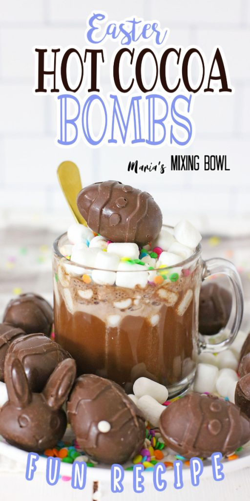 Hot cocoa bombs surrounding mug of hot cocoa topped with hot cocoa bomb