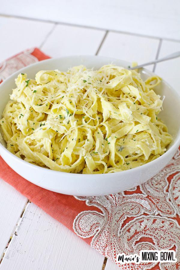 pasta in a white bowl on an orange napkin