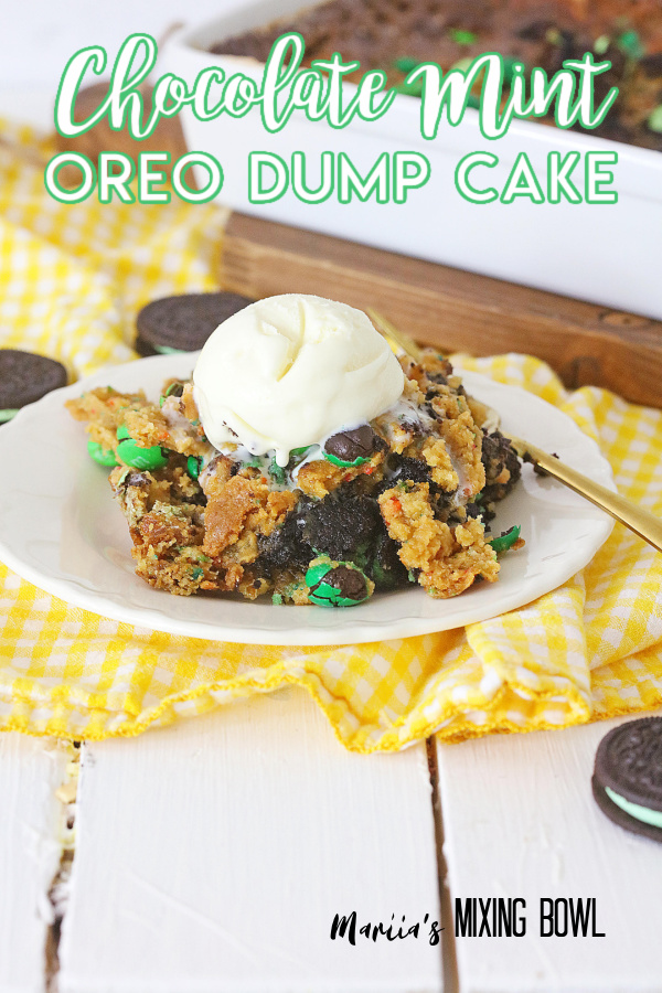 Piece of chocolate mint Oreo dump cake topped with ice cream on white plate
