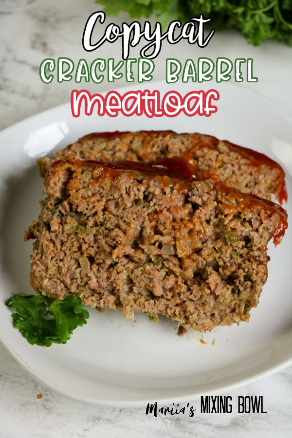 Two slices of copycat cracker barrel meatloaf on white plate