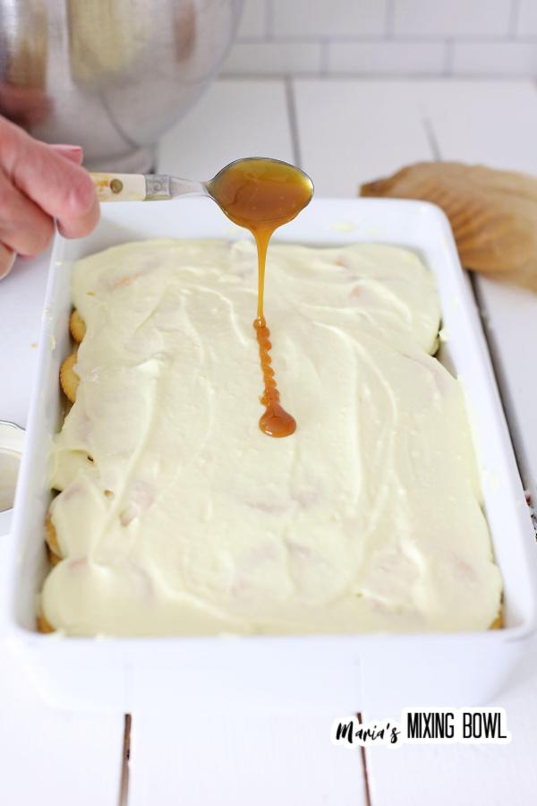 Drizzling Ritz cracker icebox cake with caramel sauce