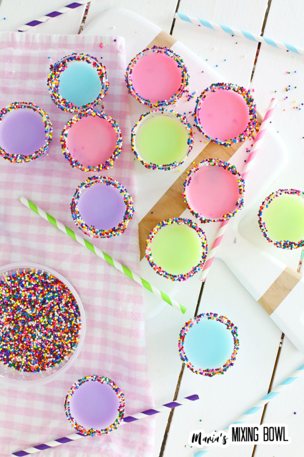 Overhead shot of colorful birthday cake shots on cutting board