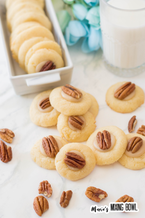Thumbprint cookies with pecan on white table