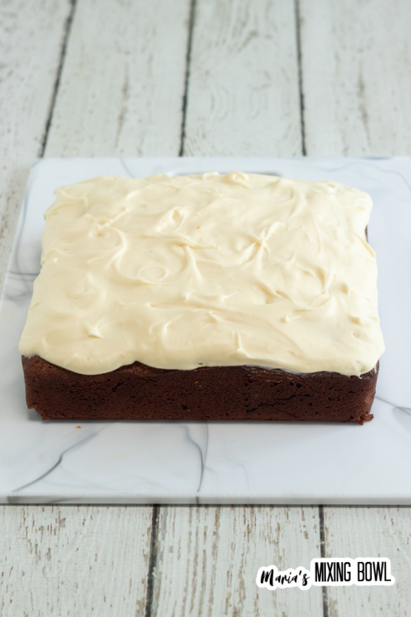frosted brownies on a marble board