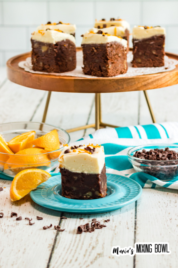 brownies on a blue plate and cake stand