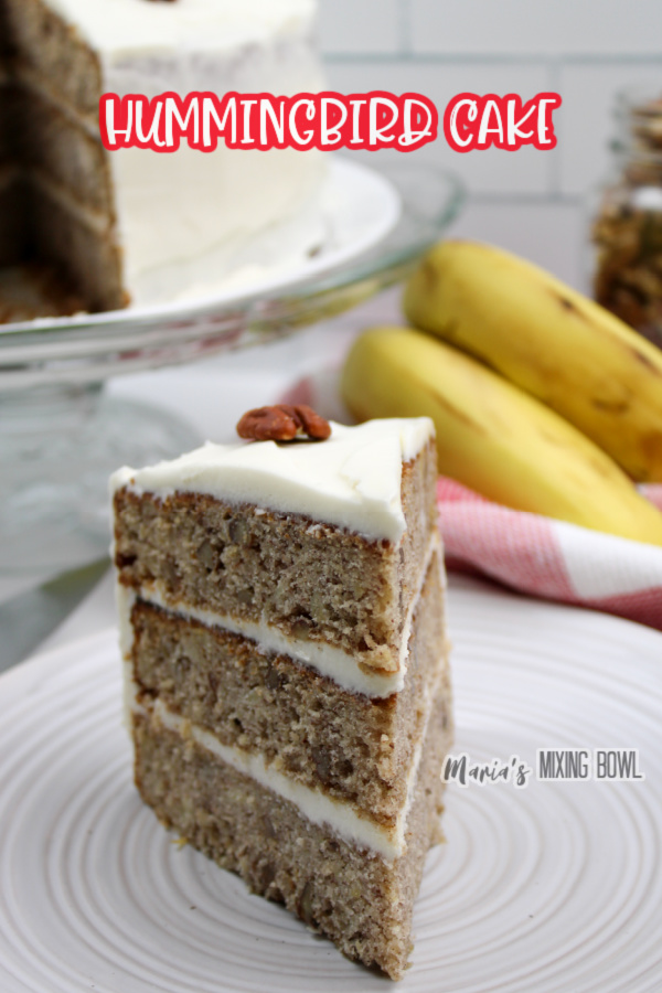 Slice of old fashioned hummingbird cake on white plate