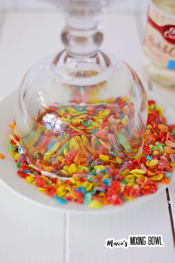 Glass turned upside down and dipped in Fruity Pebbles