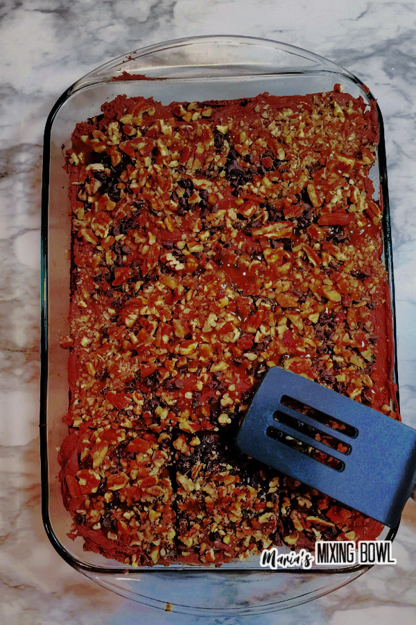 Overhead shot of cake in glass baking dish with spatula laying on top
