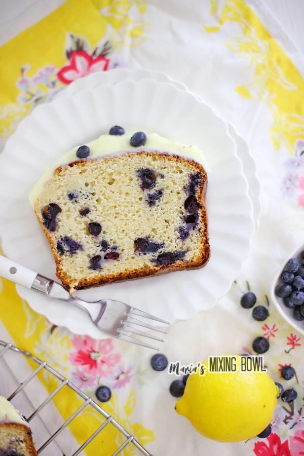 Overhead shot of slice of lemon blueberry ice cream bread on white plate.