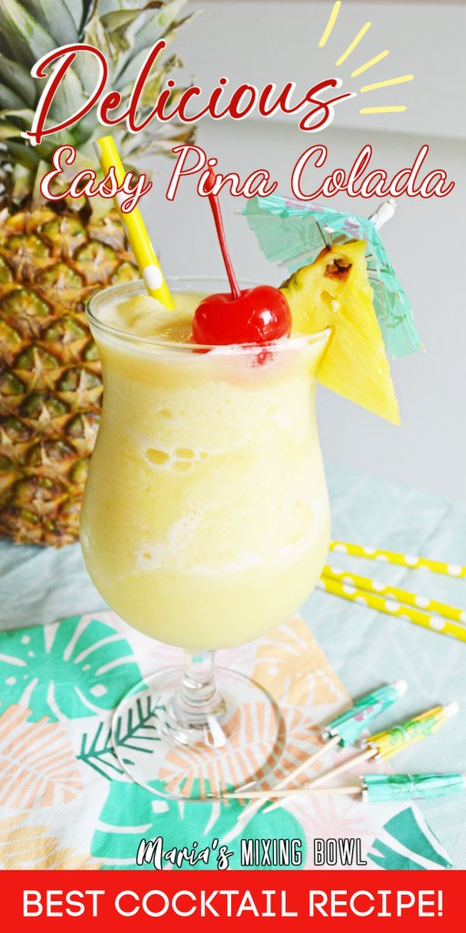 Pina colada with cherry and pineapple, umbrella and straw and pineapple in the background