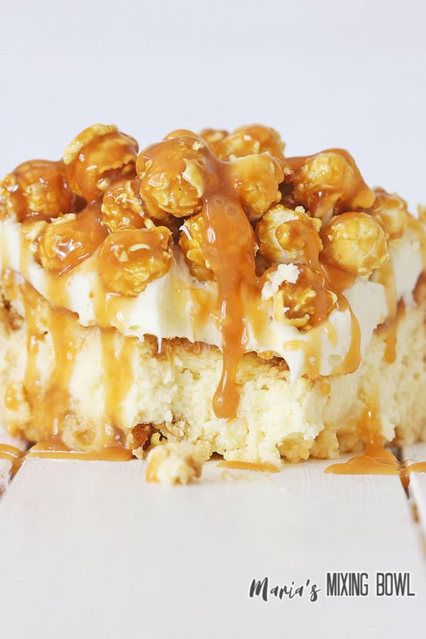 Closeup shot of slice of caramel corn cheesecake.