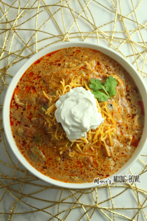 Soup with sour cream in a white bowl