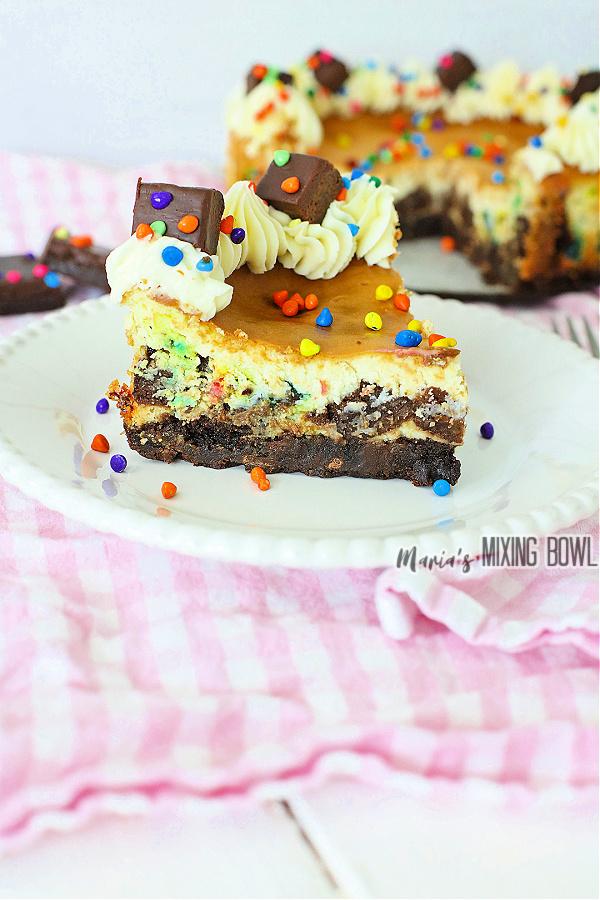 Slice of cosmic brownie cheesecake on plate