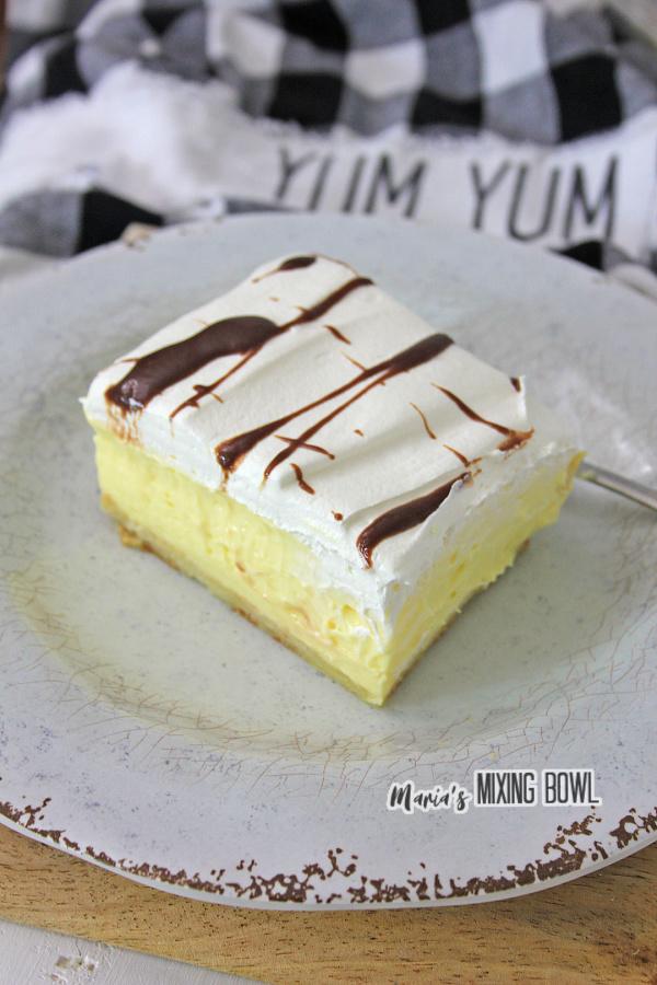 Slice of cream puff cake on white plate