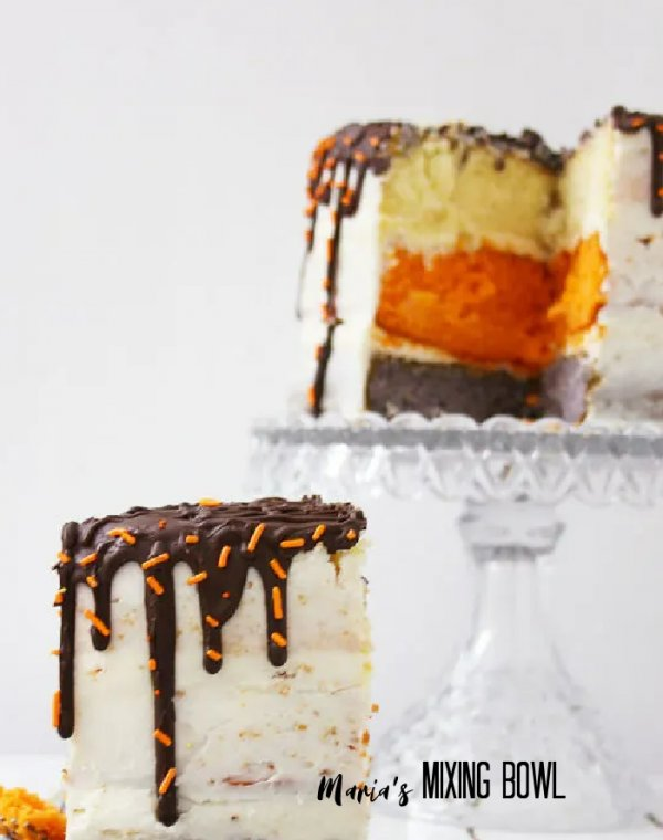 Slice of cake with more cake on cake stand in background